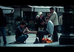 Foot Massage (N.D.K.K.) Tags: madrid street city people urban espaa film strange digital photoshop movie geotagged photography photo calle spain europa europe strada raw dof gente zoom bokeh retrato candid eu ciudad olympus stranger fotos format cinematic dido zuiko 43 oly evolt e500   zd  olympuse500 40150mm strase
