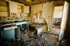 kitchen disaster (Sam Scholes) Tags: door old wallpaper house green abandoned kitchen yellow trash digital rural utah decay tan dirty hallway doorway peelingpaint decrepit cabinets rubble cupboards hiawatha d300 kingcoal usfco unitedstatesfuelcompany