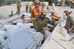 Rescue from the Rubble (Israel Defense Forces) Tags: rescue building soldier israel search women helmet collapse soldiers vest rubble idf civilian searchandrescue israeldefenseforces homefrontcommand