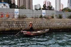 Aberdeen Harbour, Hong Kong (MikePScott) Tags: china camera sea skyscraper buildings lens hongkong boat transport kowloon southchinasea aberdeenharbour builtenvironment nikon18200mmf3556 nikond300 featureslandmarks