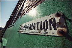 """Information"" (Eric Flexyourhead) Tags: old blue sky canada building brick green sign vancouver bc britishcolumbia clear lensflare worn weathered information alsco westfourth olympusep1 panasoniclumix714mmf40"