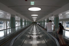 assembly line (maybemaq) Tags: travel light people travelling window lines station silver lights vanishingpoint airport asia pattern geometry travellers columns corridor july tunnel korea structure line passengers transit seoul repetition passage incheonairport recent incheon handrails assemblyline republicofkorea mbius hiliday internationalflight maybemaq airportjob