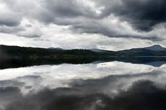 Loch Ard - between heaven and earth (press 'L') (manolo guijarro) Tags: lake reflection water clouds lago scotland agua nikon escocia cobblestone nubes reflejo loch manolo guijarro lochard d700 manologuijarro mccobblestone lagoard