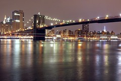 The shadows of the highway play across the water of the river, under the #BrooklynBridge, at night.  The city of Manhattan looks lit up, and the waters of the EastRiver look patterned, and aglow with the LightTrails from the traffic of boats.  June 5th, 2 (faisal_halim) Tags: longexposure nightshot brooklynbridge longexpo newyorkig madeinny atlanticnortheast nightshooters newyorkinstagram igmood instaghesboro ignorthamerica ignewyork ignycity nycexplorers iggreatshotsnyc agameoftones nycdotgram topnewyorkphoto moodygrams iglobalphotographers igcolor loadedlenses unlimitedusa streetsvision picturenyc longexposureelite narcitynewyork unlimitedmanhattan thatssomanhattan