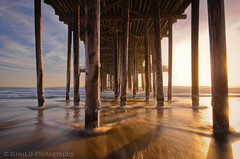 Pismo Beach (Silent G Photography) Tags: ocean california ca sunset pier waves glow pacific motionblur filter nd centralcoast pismo pillars pismobeach highway101 hightide 2012 hoya reallyrightstuff rrs neutraldensity pismopier watermovement bh55lr nikond7000 nikkor1635mmf4 5stopndfilter markgvazdinskas silentgphotography reallyrightstuffllc tvc33