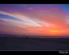 Silhuette (Khalid.Amin) Tags: ocean blue pakistan sunset red sea sky orange beach clouds canon eos evening dusk bank arabian karachi seaview vag silhuette 500d wow1 wow2 fga flickraward heartawards platinumheartaward flickraward5