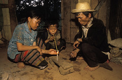DRUG ADDICTION Northern Thailand. Thai family addicted to opium, their child smoking opium. image photo photograph (Homer Sykes) Tags: family boy woman house man home children thailand kid southeastasia child farmers interior father pipe mother smoking thai illegal drug addicted opium addiction addict abuse banned peasant hilltribes goldentriangle chasingthedragon travelstock
