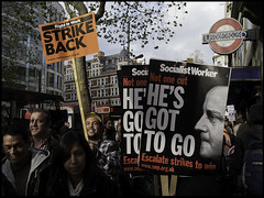 Got to go! (Sven Loach) Tags: uk morning november england signs david building tree london smile station 30 canon underground demo march workers britain nation tube protest photojournalism sunny cameron holborn posters strike protesters n30 placards reportage conservatives tories g12 swp strikers 2011 publicsector bullingdon socialistworker condem righttowork
