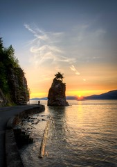 Vancouver Stanley Park: Siwash Rock at Sunset (Mike Heller) Tags: sunset vancouver day seawall stanleypark siwashrock hdr d800 polarizingfilter ndfilter 2470mmf28 siwashrocksunset TGAM:photodesk=sunset2012 pwpartlycloudy