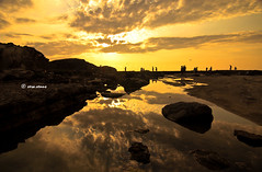 before sunset along the rocks (Vera Venus) Tags: sunset silhouette serene tranquil pagudpud ilocosnorte lovelysunset yellowsunset romanticsunset kapurpurawanrock