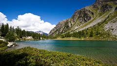 Lago d'Arpy (Ennio66) Tags: park flowers autumn sky italy panorama mountain lake snow mountains alps flower color macro tree ice nature rock fauna clouds montagne alpes trekking canon landscape lago lights landscapes flora italia nuvole day colours shadows estate cloudy hiking atmosphere valle august natura hike glacier cielo valley neve monte ao alpen sentiero courmayeur inverno alpi paesaggi montagna italie montblanc paesaggio aosta monti montebianco ghiaccio valledaosta valdaosta panorami granparadiso escursionismo arpy planaval laghidarpy laghidiarpy