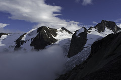 The Bugaboos - Clouds Rising (Tideline to Alpine Photo, Idiosyncrasy Exemplified) Tags: camping sky snow mountains expedition clouds spires glacier adventure climbing alpine mountaineering wilderness houndstooth basecamp alpinism bugaboos thebugs marmolata alpineclimbing bugabooprovincialpark applebeecamp applebeedome