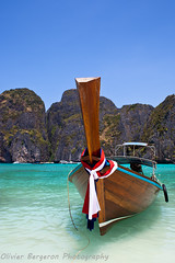 Long tail boat in Maya Bay - Krabi - Thailand (funkytravel) Tags: ocean voyage wood trip travel blue light sea portrait hot green tourism stone swimming swim landscape asian thailand hotwater boat cool sand colorful asia warm heaven paradise redribbon turquoise dream scuba diving nopeople snorkling thai ribbon asie emerald longtailboat krabi reve bluegreen blueribbon ruban andamansea farniente waterscape mayabay woodboat whiteribbon nohuman prou