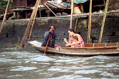19-430 (nick dewolf photo archive) Tags: people woman baby color film water 35mm thailand boat canal women infant child bangkok nick paddle thai oar watersedge 1970s 1972 19 youngwoman 1973 klo