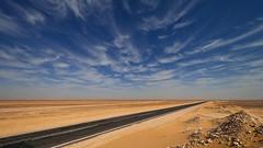 Through the Desert (uwe.werling) Tags: road travel sky sahara clouds sand desert egypt himmel wolken roadtrip discovery gypten wste uwe reise strase libyandesert werling flickrtravelaward