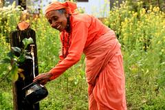 Water (Dick Verton ( more than 13.000.000 visitors )) Tags: travel nepal orange woman water garden asia watertap devghat colorfulwoman dickverton