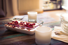 Raspberry dessert on wooden shabby chic table (thethomsn) Tags: light stilllife food home fruits table dessert wooden yummy candle dof sweet bokeh livingroom delicious indoors raspberry creamy shabbychic thethomsn