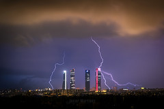 Tormenta en Madrid (Javier Martnez Morn) Tags: madrid city light urban espaa storm weather night clouds cuatro noche lluvia spain long exposure sony ciudad paisaje telephoto nubes tormenta tele urbano lightning fe alpha rayo moran javier cristal martinez exposicion larga torres tiempo ctba cepsa sonyalpha 55210 jmartinez a6000 jmartinez76