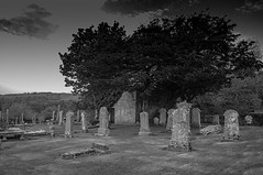 Through The Ages Time Stands Still (Brian Travelling Getty Contributor) Tags: old uk trees blackandwhite white black tree cemetery grave graveyard grass landscape outdoors mono scotland interesting ancient scenery pentax unitedkingdom outdoor scenic peaceful tranquility graves historic hills serenity gb serene kr tranquil inverclyde inverkip westofscotland pentaxdal pentaxkr oldinverkipcemetery