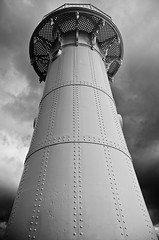 (mblaeck) Tags: blackandwhite bw lighthouse monochrome weather architecture clouds outside blackwhite outdoor lookingup column badweather wollongong wollongongharbour breakwaterlighthouse wollongongbreakwaterlighthouse
