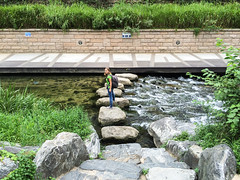 Young woman on the bridge (Evgeny Ermakov) Tags: life city bridge urban woman green water smile smiling rock stone stairs warning river stand board young lifestyle sneakers trainers rapids jeans seoul kr southkorea youngwoman keds modelrelease cheonggyecheon