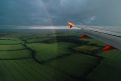 In between rain and sun. ( www.ethanleephoto.com) Tags: life travel green field landscape fly rainbow nikon flight wing aerial nikkor luton easyjet d4 2495mm