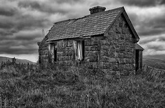 Bleak House (f0rbe5) Tags: bleakhouse bleak house bothy abandonedbothy cottage residence derelict building architecture tworoom outhouse corrugatedironouthouse corrugatediron corrugated iron slateroof slate roof stone tile grass clouds stormyclouds stormy scene curtains elphin ailbhinn croftingtownship crofting township bw blackandwhite monochrome assynt highlands sutherland scotland uk 2015