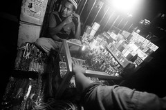 WHO THAT BE? (Junayed Sadat) Tags: life street people blackandwhite face dark raw technology phone d70 tokina dhaka 1224mm bangladesh internationalworkersday bangladeshiphotographers baitulmukarrammosque junayedsadat