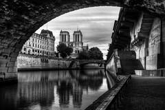 Notre Dame (Michel Couprie) Tags: city bridge blackandwhite bw paris france church seine architecture clouds stairs canon river eos cathedral noiretblanc notredame reflect frame 7d pont escalier hdr quais
