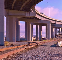 Railroad overpass (Indiecent Exposure-Blockton Photography) Tags: road park industry concrete oakland highway bars san francisco industrial steel tie engineering overpass railway trains cargo freeway processing skyway railrod manufacturing byway