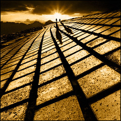Yellow brick Road (adrians_art) Tags: sunset sky people cloud abstract lines sepia shadows squares patterns sunbursts