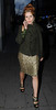 Paloma Faith chats on her mobile phone while walking in Mayfair London, England