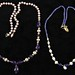 5002. Two Cultured Pearl and Gem Set Necklaces