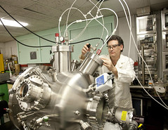 A scientist at Naval Surface Warfare Center adjusts the flow of argon gas. (Official U.S. Navy Imagery) Tags: md unitedstates research rd scientist argongas rdte navalsurfacewarfarecenter indianheaddivision drvictorbellitto depositionchamber novelenergeticmaterials