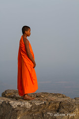 Novice monk at Preah Vihear rocks (alison ryde - back in town for now) Tags: voyage travel orange holiday temple asia cambodia southeastasia monk buddhism angkorwat unescoworldheritagesite indochine phototrip indochina 2014 preahvihear