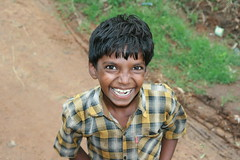 fascinating smile of a poor boy (hatschiputh) Tags: boy green smile poor kerala land