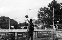 Olympus Mju II - Man Playing with a Ball at Tram Stop (Kojotisko) Tags: bw streetphotography brno creativecommons czechrepublic streetphoto rodinal fomapan100 mju2 olympusmjuii