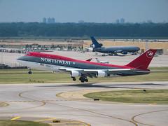MSP N673US (Skeeter Photo) Tags: canon msp boeing g3 takeoff 747 jumbojet northwestairlines 747400 runway22 kmsp b744 minneapolisstpaulinternationalairport n673us 747451 queenoftheskies nwa19
