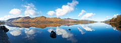 Derwentwater Reflections Panorma (mark_mullen) Tags: uk england panorama mountains english nature water beautiful rural reflections landscape countryside scenery shadows natural britain lakedistrict scenic british derwentwater blueskies keswick tranquil canon1740f4 canon1dsmkii stitchedpanorama b5289 markmullenphotography