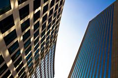 L'homme pressé / The busy man (fidgi) Tags: blue sun paris building tower architecture canon soleil torre tour bleu ladéfense yabbadabbadoo canoneos7d tourtechnip