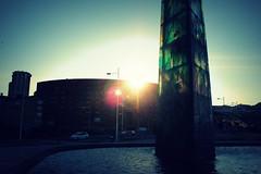 When the sun goes down... (jose_anta) Tags: blue light sunset sea sky sun reflection green tower water glass skyline sunrise canon mar reflex spain corua ray cityscape shadows millenium galicia maritim 550d luminic