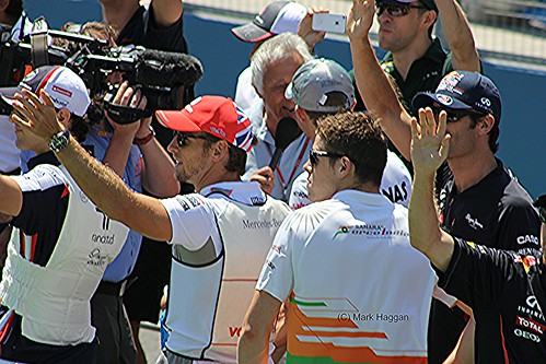 Jenson Button and Paul di Resta on the drivers' parade before the 2012 European Grand Prix in Valencia