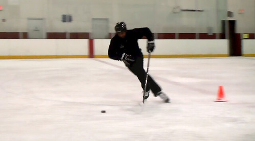 Brad Perry showing a crossover with a puck