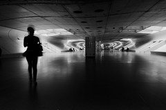 Blurry silhouette (t3mujin) Tags: light shadow bw woman man portugal station dark waiting lisbon tunnel oriente passage