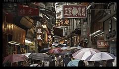 _5006769 copy (mingthein) Tags: life china street people hk wet rain digital umbrella four bokeh availablelight streetphotography olympus hong kong workshop micro pj macau ming zuiko 43 omd reportage thirds m43 onn zd mft em5 4518 thein photohorologer micro43 microfourthirds mingtheincom zuiko4518