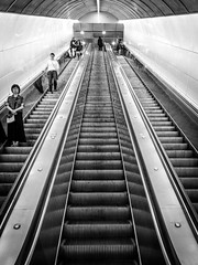 Going Up (Jason Gallant.) Tags: blackandwhite bw lines metal vancouver canon eos lights geometry granville escalators 18200mm granvillestation leadingline 60d
