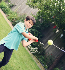 IMG_5295a (Helen Schryver Connolly) Tags: boy summer portrait blackandwhite baby playing colour cute boys smile grass smiling wall garden children fun outdoors football jump jumping sitting child natural action expression group naturallight trampoline tennis kicking swingball