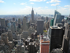View from the Top of the Rock (DennisGRILLT) Tags: new york city nyc bridge cloud ny building tower apple rock skyline clouds skyscraper river big amazing nikon rocks view skyscrapers state top manhattan south united sunny center canyon esb empire april hudson states aussicht rockefeller manhatten 2012 hochhaus hochhuser p7000 huserschlucht