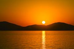 Red Dawn (Maskedmarble) Tags: sea dawn hills greece