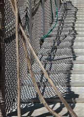 The blue rope (mennomenno.) Tags: haven net harbour scheveningen thenetherlands fences trap hekken shadowlight schaduwlicht